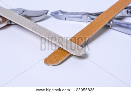 Cardboard nailfiles and nippers on a white background. ** Note: Shallow depth of field