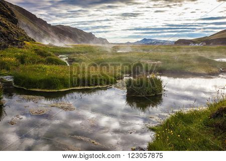Sunrise Park Landmannalaugar. White nights in Iceland. Hot steam over the source of the thermal waters