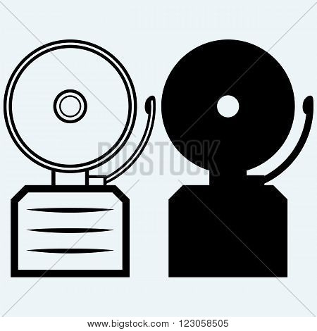 Alarm bell. Isolated on blue background. Vector silhouettes