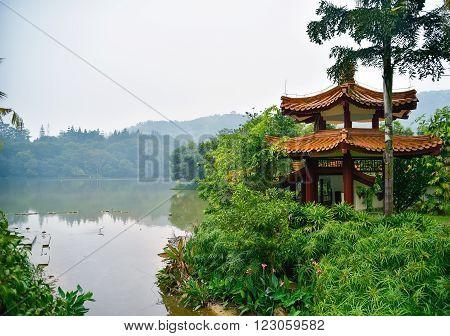 View on flamingo and pagoda on the lakeside