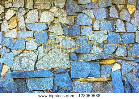 Stone wall bright rich texture background. Horizontal shot high saturation.
