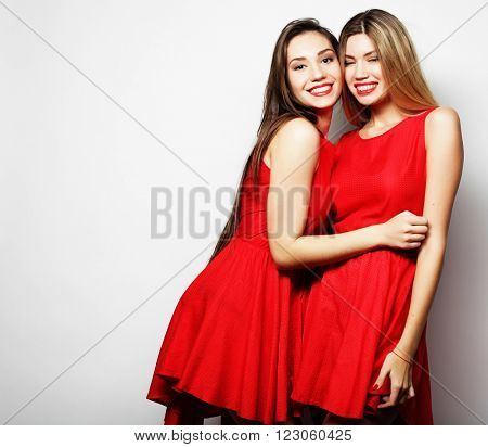 Picture of a charming young girls in red dress on white background
