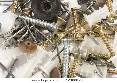 Background in the industrial style (screws, screw nails, nailing plugs and nails)