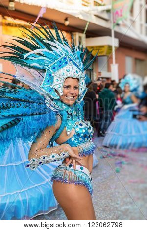 LOULE, PORTUGAL - February 2016: Cheerful carnival Carnaval parade in the city of Loule, Algarve, Portugal. Participants cheer people.