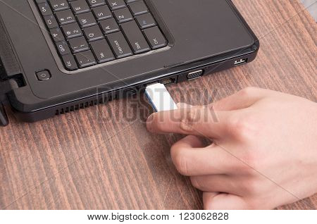 Hand Inserting usb memory stick to laptop computer