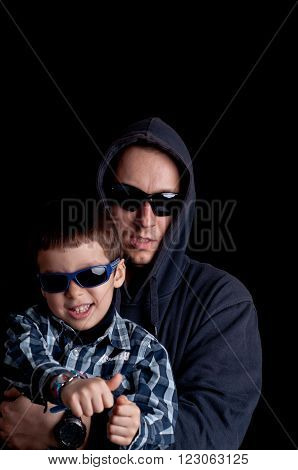 Portrait of young boy with daddy wears sunglasses and hoodie