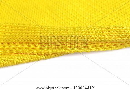 Piece of knitting work - yellow yarn stitches - macro