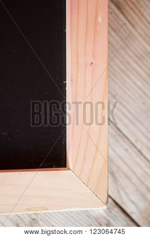 corner of chalk board with wood frame