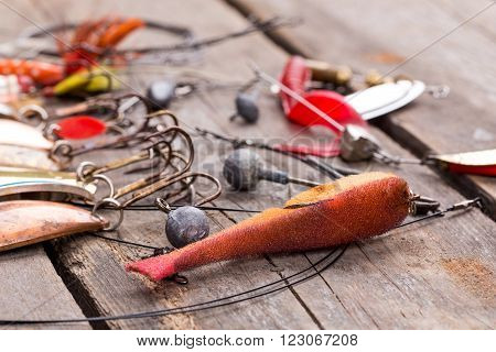 Fishing Tackles And Spoon On Wooden