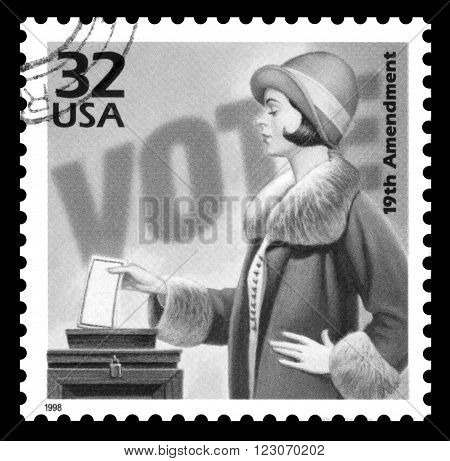 London, UK, March 23, 2012 : USA vintage 1970's postage stamp commemorating 50 years of the women's suffrage movement, black and white image