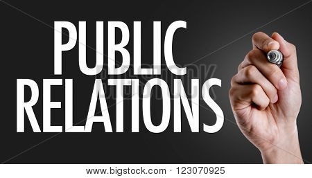 Hand writing the text: Public Relations
