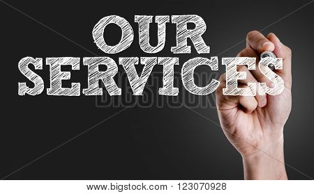 Hand writing the text: Our Services