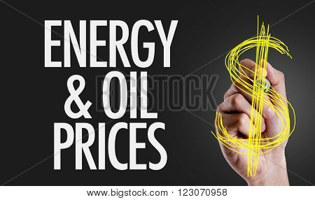 Hand writing the text: Energy & Oil Prices