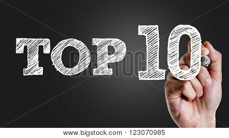 Hand writing the text: Top 10