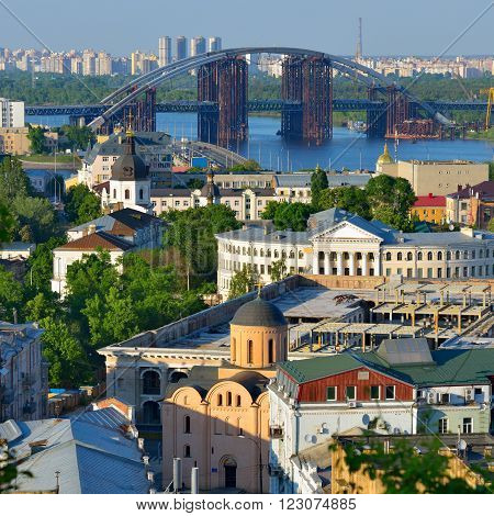 Capital of Ukraine Kyiv. Beautiful view of the old district of Podil and the Dnieper River in Kiev.