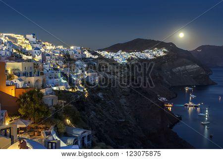 Moonrise above the village of Oia, Greece, Santorini