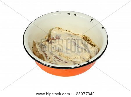 Fish in the marinade. Isolation on a white background. Clipping path.