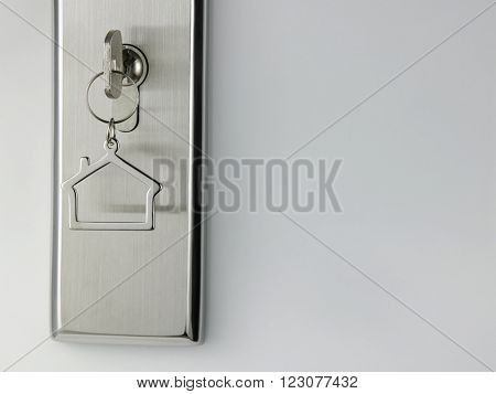 house shaped key chain at the door access