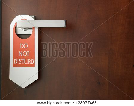 do not disturb door sign hanging at door handle