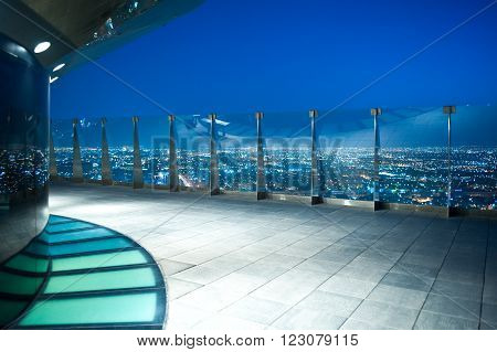 Rijadh,  Saudi Arabia - November 14, 2007:  Night view of the city from the Al Faisaliah tower terrace.