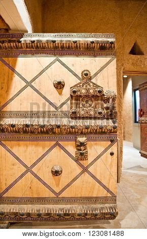 Riyadh,  Saudi Arabia - November 29, 2008:  A decorated door in he inside of the Masmak Fortress (XIX century) in the old city center.