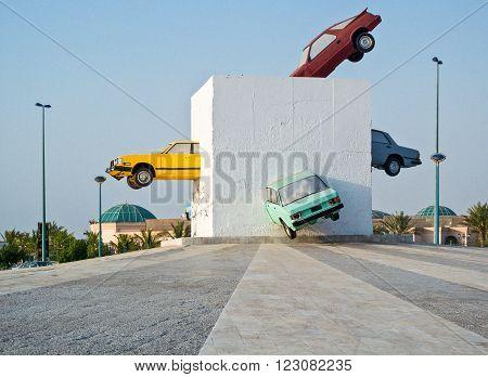 Jeddah, Saudi Arabia - November 20, 2008: A monuent with cars in the Corniche area.