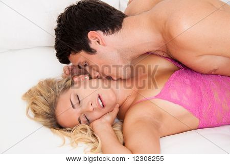 Couple in bed with sex and affection. Love and E