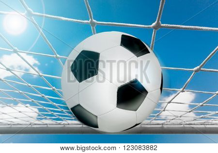 Soccer net the ball and the sky close up