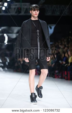 ZAGREB,CROATIA-MARCH 17,2016:Model wearing clothes designed by Coded Edge on the Bipa Fashion.hr fashion show in Zagreb, Croatia. Coded Edge is Croatian fashion label,by Silvio Ivkic and Jure Perisic.