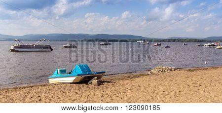St-Gabriel-de-Brandon Qc Canada - July 30 2015 : View of Maskinongé Lake beach and mountains landscape St-Gabriel-de-Brandon town Quebec Canada at summer time