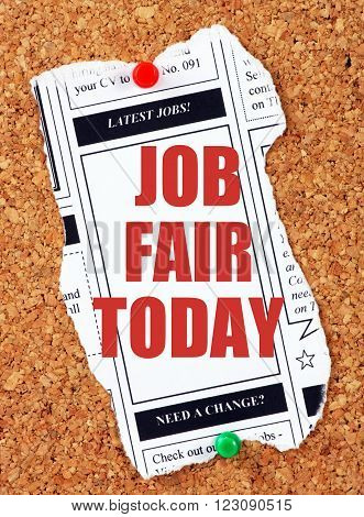 Newspaper clipping from the classified advertising section with the words Job Fair Today in red text and pinned to a cork notice board