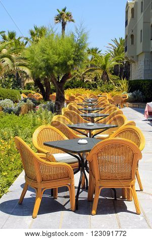 CRETE, GREECE - JULY 23, 2015: Al fresco wicker seats on the mediterranean hotel terrace, Crete, Greece