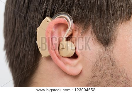Close-up Photo Of Ear With Hearing Aid