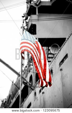 The American flag waves in front of a warship. ** Note: Soft Focus at 100%, best at smaller sizes