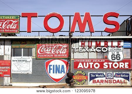BARSTOW, CALIFORNIA - DECEMBER 22: A workshop with a large number of old vintage and retro label signs of different brands on December 22 2015 in Barstow.