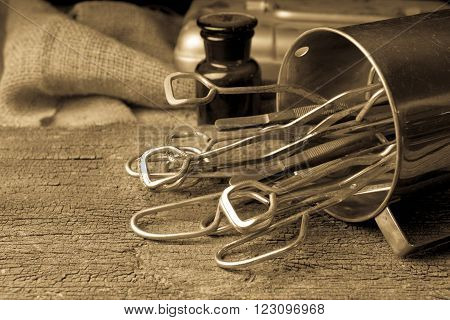 Old medical equipment on old wood background