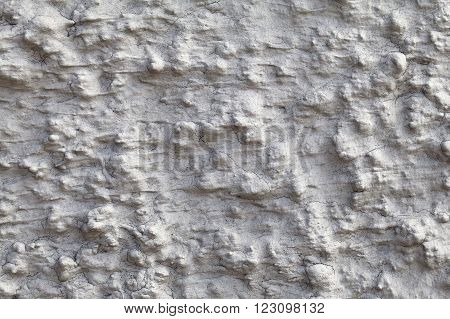 Macro shot of uneven wall plaster, texture