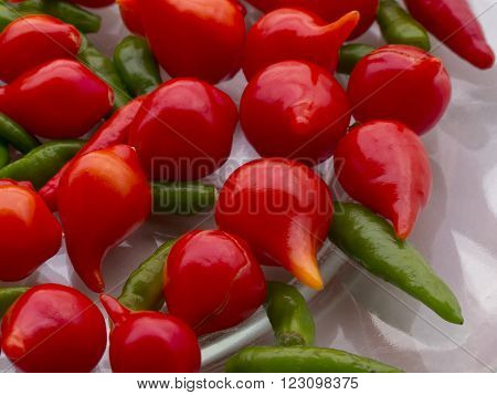 Plate with red pepper pout and green chilies
