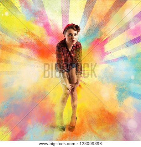 Pin-up with burst bright colored powders background