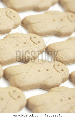 A row of ginger bread men on white background.