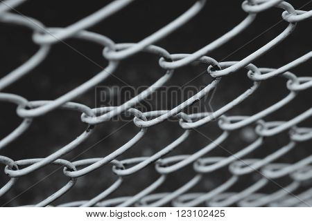 Closeup of wire mesh fence with selective focus