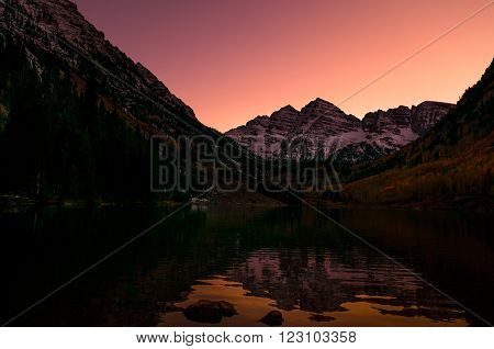 Maroon Bells reflection after Sunset Elk Mountains Aspen Colorado Famous USA landscape