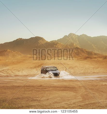 Offroad SUV riding in the desert