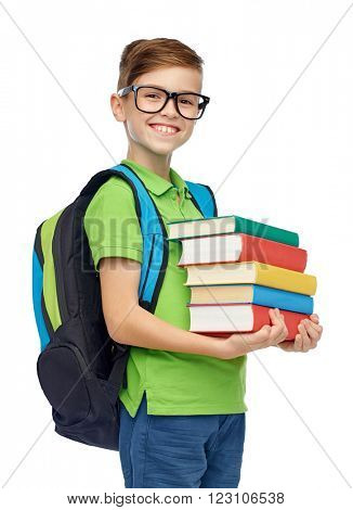 childhood, school, education and people concept - happy smiling student boy in eyeglasses with school bag and books