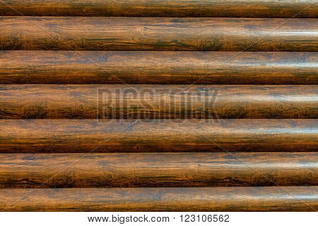 New log texture as background with a copy of the space. Brown horizontal logs texture.