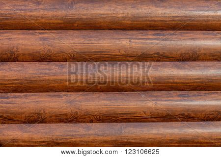 New Brown log texture as background with a copy of the space. horizontal logs texture.