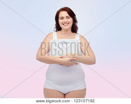 weight loss, diet, slimming, plus size and people concept - happy young plus size woman in underwear holding scales over rose quartz and serenity gradient background