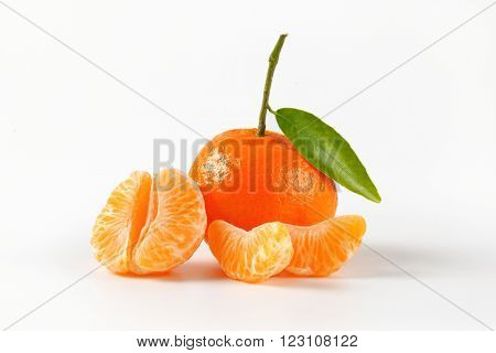 tangerine with separated segments on white background