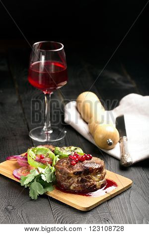 Grilled Steak Meat on the wooden surface. Rustic background