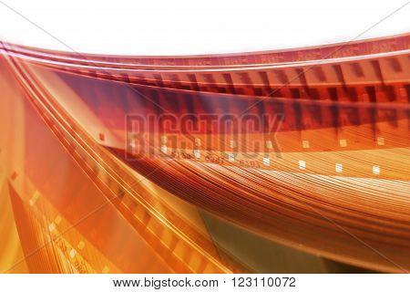 Film background 16 mm. blurred movie film reel.
